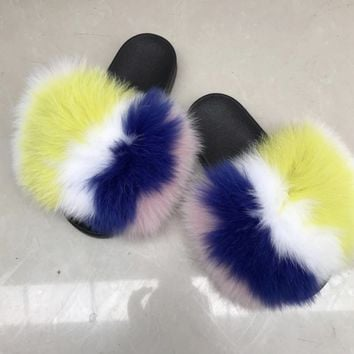 Surprise fox fur slides