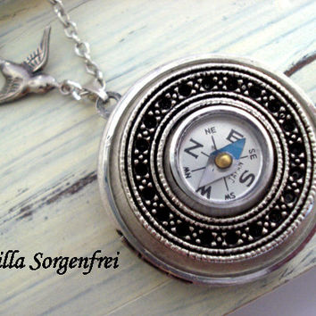 Show Me the Way - silver locket necklace with compass and little swallow