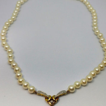 Stunning Pearl Necklace with 10 kt gold heart with a solitaire diamond and a dangling pearl, Perfect for a bride!