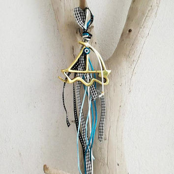Gold sailboat charm, Greek sailboat with blue eye, blue ribbons and gold beads, housewarming gift, good luck gift, Greek folk art sailboat