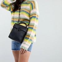 ASOS DESIGN leather push lock lid cross body at asos.com