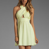 Alice + Olivia Martine Wrap Bodice Tulip Skirt Dress in Limon from REVOLVEclothing.com