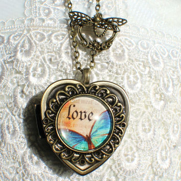 Music box locket, heart shaped locket with music box inside, in bronze with Love and Butterfly Cabochon