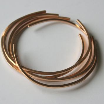 Set of five bronze cuff bracelets