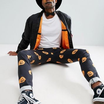 ASOS TALL Halloween Skinny Trousers With Pumpkin Print at asos.com