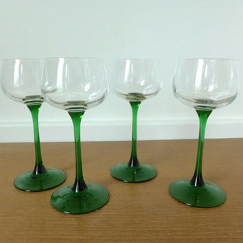 Four green stemmed hock wine glasses made in France