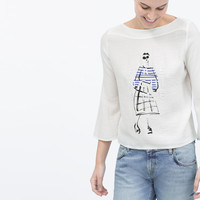 DOLL AND TEXT T-SHIRT