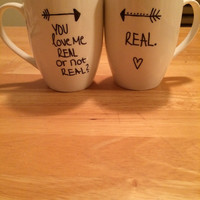 Hand drawn coffee mugs! Hunger Games: Catching Fire quote!
