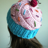 Light pink cupcake hat in a blue wrapper