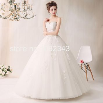 New Arrival Sexy White Tulle Strapless Sleeveless Ball Gown Wedding Dress Applique Lace Up Bridal Gown