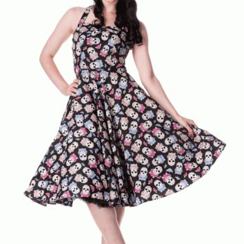 "* 50's shape halterneck dress.* Printed cotton with day of the sugar skulls and flowers.* Bust is gathered in the middle.* Self fabric halterneck straps.* Shown here with our 26"" petticoat (sold seperately).* Shirring elastic in the back.* Zip in the centr"