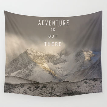 Adventure is out there. At the mountains. Wall Tapestry by Guido Montañés