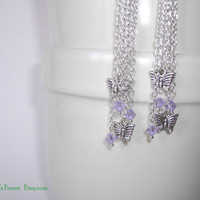 Silver plated chain earrings, with Swarovski crystals, and butterfly.