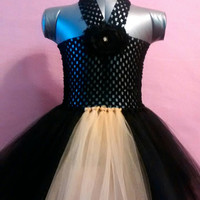 Black with a touch of yellow, baby tutu dress, size 6 months- 18 months.