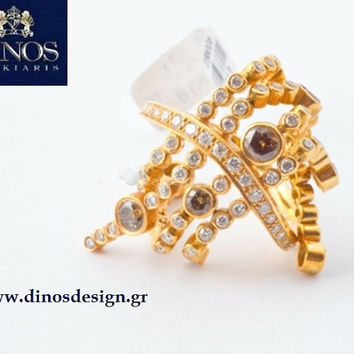 All time classic gold and diamond ring. An excellent choice for gift for her. Designed by Dinos Koukiaris.