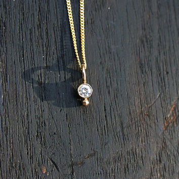 Diamond solitaire necklace. 14k solid gold and genuine round diamond on 14k solid gold chain. Small, minimalist classic jewelry. Handmade