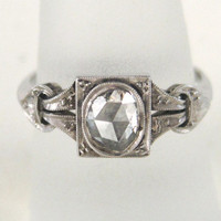 Antique Engagement Ring with Rose Cut Diamond in a Platinum Setting from the Edwardian or Victorian Era