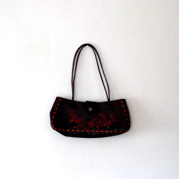 Dark red tooled floral leather bag. maroon. deep burgundy. brown. pretty. vintage. boho. 70s. handle. stitch trim. small baguette style bag