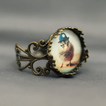 Antique Bronze Filigree Ring Chick in A Black British Bobby Hat Brass Adjustable Band