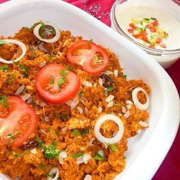 Recipes - Tasty Chicken Biryani served with a Cucumber Raita (a cooling yogurt dip)