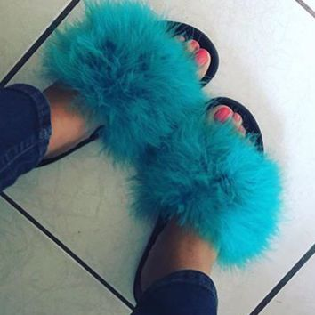 Teal Nike fur slides