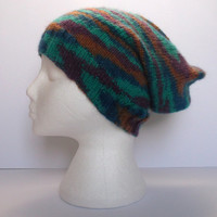 Unisex hand knitted slouchy beanie. Semi camouflage self patterning wool. Adult or teenager.