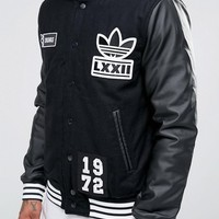 adidas Originals Badge Varsity Jacket AY9148 at asos.com