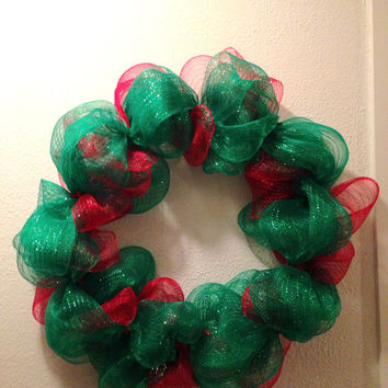 Christmas wreath. Red and green deco mesh wreath on a 16 inch frame