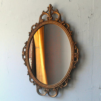 Gold Oval Mirror in Ornate Vintage Brass Frame - 17 by 12 inches