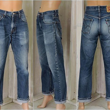 Vintage Levis 505 jeans / 30 X 32 size 7 / 8 / high waisted / straight leg / medium wash faded