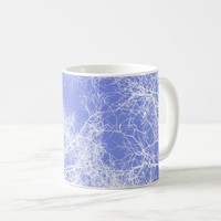 Blue and white silhouetted trees coffee mug