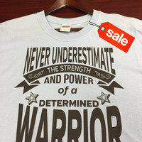 On Sale: Never Underestimate The Strength and Power of a Determined Warrior Light Blue Shirt (FREE SHIPPING in U.S)