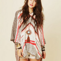 Free People Rising Tides Hooded Poncho at Free People Clothing Boutique