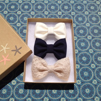 Beautiful lace navy and winter white hair bow by theSeasideSparrow