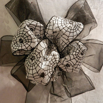 Black and White Halloween Bow printed with Spiders and Webs on a sheer black ribbon bow
