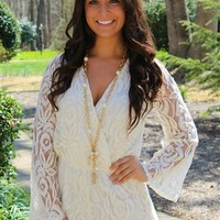 Long sleeves lace romper fully lined with a v neck.