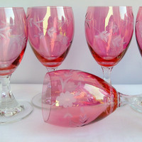 Six pink etched glass wine glasses