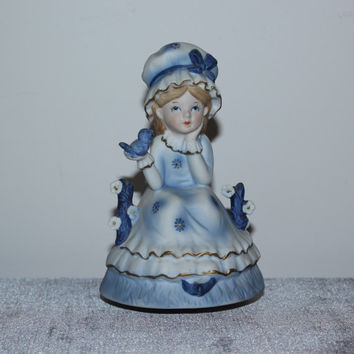 Porcelain girl in bonnet holding bluebird rotating musical figurine, collectible figurines, vintage figurines,