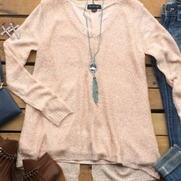 Our Let Him Fly Sweater is the perfect amount of sass and class! It's a sweater with sequin detail. V-neckline and is lined. Made to be loose fitted.