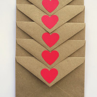 brown kraft paper envelopes with red hearts