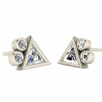 Edgy diamond earrings:  trillion diamonds bezel set in a geometric design using recycled gold