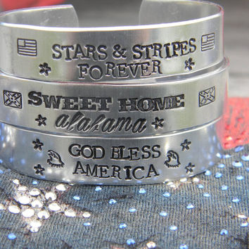 Fourth of july, patriotic bracelets, god bless america, sweet home alabama, starts and stripes forever one aluminum bracelet 1/2  inch wide