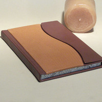 Journal, diary, leather cover with double colour leather, closing with magnet, asymmetrically