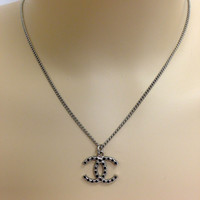 Chanel Silver Logo Necklace With Black Embedded Strass Detail