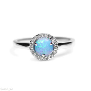 Sterling Silver Light Blue Opal and CZ Halo Ring