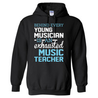Behind Young Musician Is An Exhausted Music Teacher - Heavy Blend™ Hooded Sweatshirt