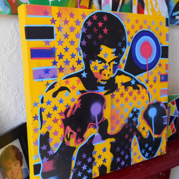 painting of muhammad ali on box canvas,stars and stripes,stencils & spraypaints,posca,sport,america,boxing,yellow,target,gloves,icon
