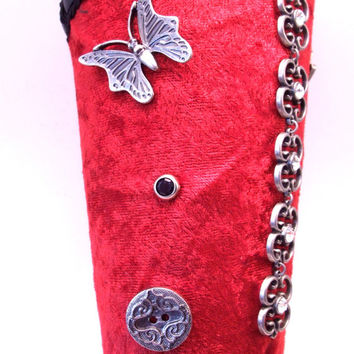 Steampunk Bracer made from Leather with Crushed Red velvet covering.