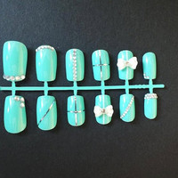 Aquamarine nails with 3D bows and rhinestones