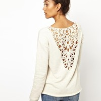 River Island Long Sleeve Lace Back Sweat at asos.com